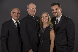 From left to right... Fran Conte, Fr. Engh, Erin Conte, and Cody Bedell